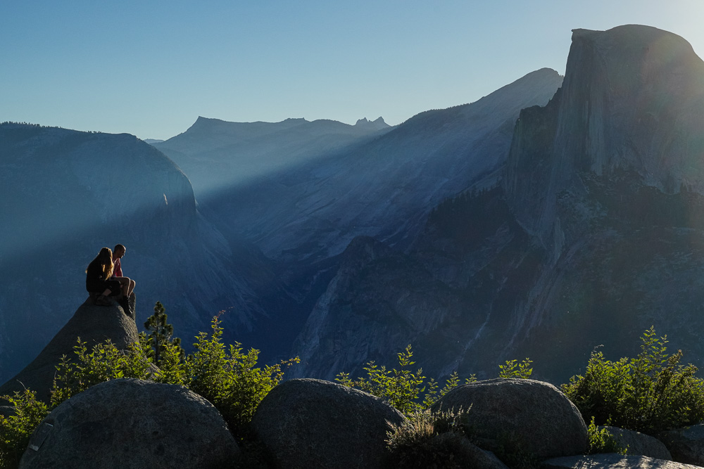A Young Couple Watches the Sunrise Over Half Dome In Yosemite
